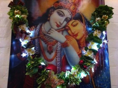 remember krishna radha decorated with garland with fairylights poster