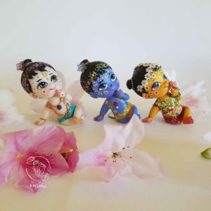 set of krishna radha and balaram dolls for children. dolls are very cute with peacock feather and decorations