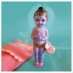 krishna doll for sale pink sleeping bed and turquouise background conchell peacock feather
