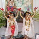 Nitai Gaur deities sita's lords raised arms chanting and dancing deities beautifully dressed and decorated with flowers and wigs