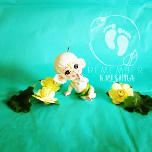 white hanuman doll for sale on blue turquoise background yellow flowers and big eyes cute green dhoti