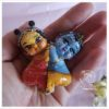 Radha and Krishna nestled together in a heart of love radha krsna. The shape is so sweet. held in palm of hand krsna doll and radha doll make radhe radhe happy