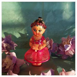 radha doll wearing skirt cuteness
