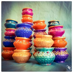 butterpots gaily painted decorated with jewels minature butter pots for Krsna and balaram multi color indian diwali
