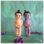 krishna balaram deities with blue and white skin and flower garlands