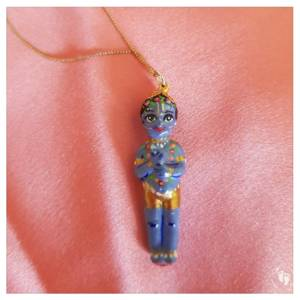 Krishna pendant standing with flute ready to wear as a necklace