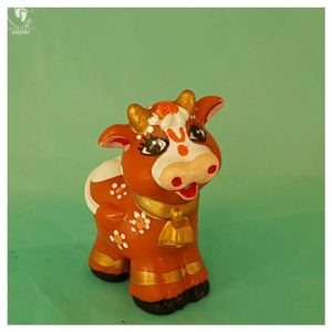cow brown with ornaments gold horns and friendly long eyelashes krishna's friend cow toy