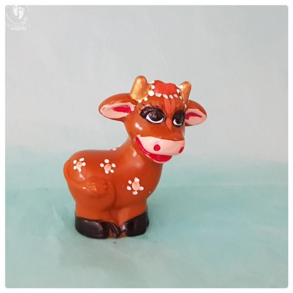 little toy goat nicely decorated and ornamented