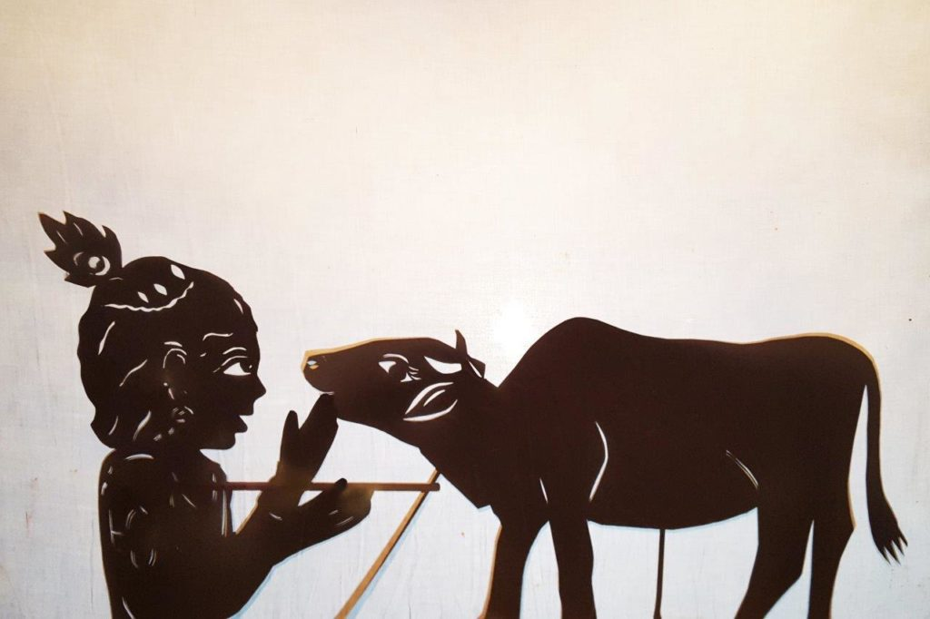krsna and cow shadow puppet