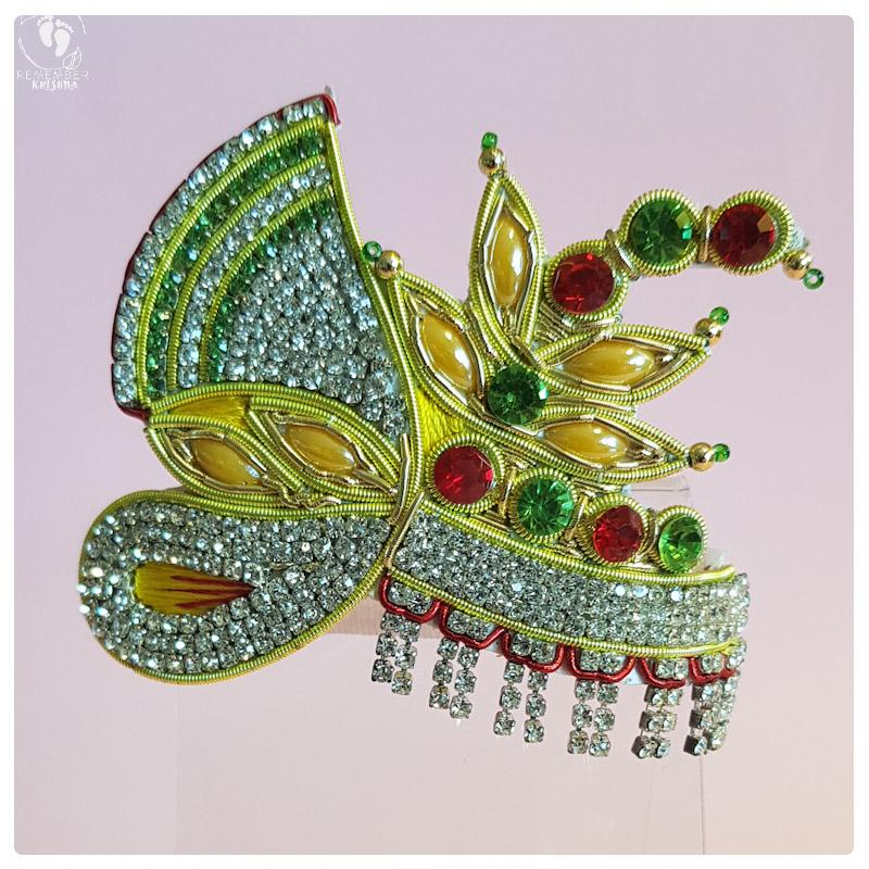 opulent and princely, this crown has the shape of a turban and unique falling fringe of studded gemstones.