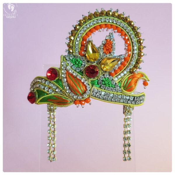 GOrgeously colored orange, yellow red and green, all the colors of indan in this beautiful crown for Radha Krsna