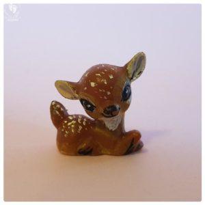 sitting deer on hand tiny little fawn minature friend of krishna doll
