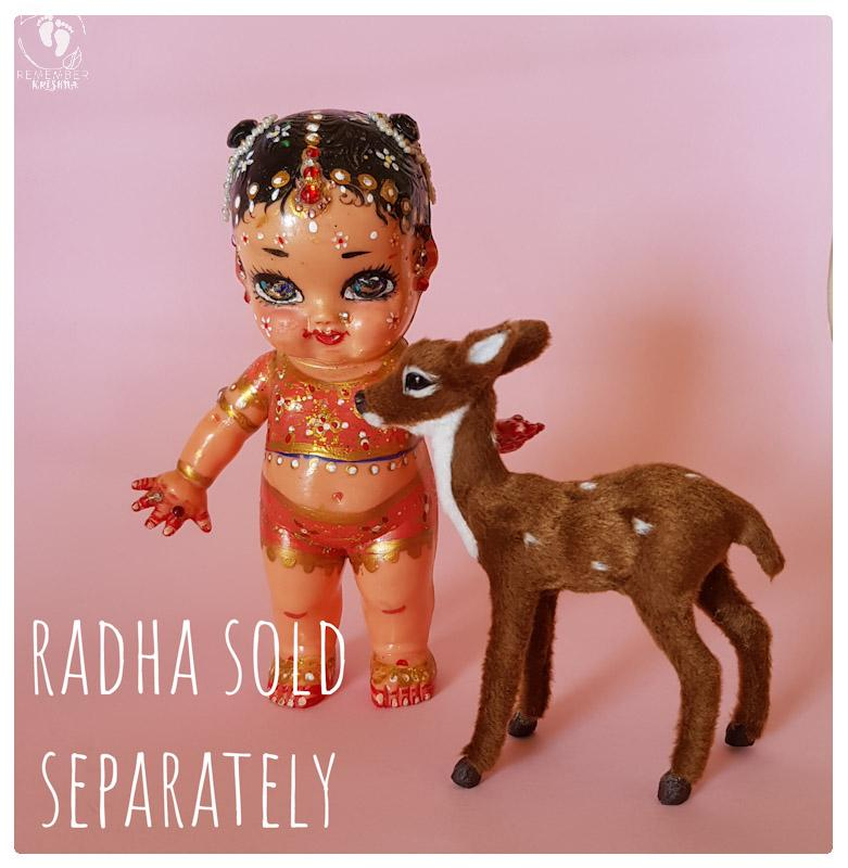 deer and Radha doll standing on pink background cute accessories and krishna's animal friends