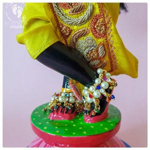 Deity of Krsna standing on lotus flower base wearing pearl anklets