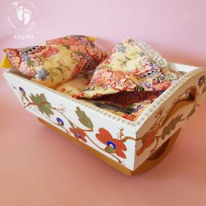 rocking cradle for Krsna dolls painted white ry bedding wooden cradle on pink background