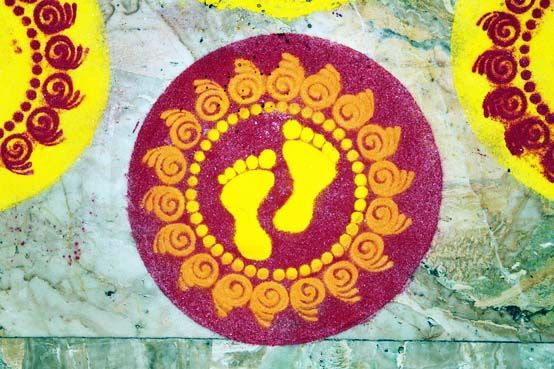 rice flour traditional rangoli decoration stencil on marble floor colorful yellow magento and green marble