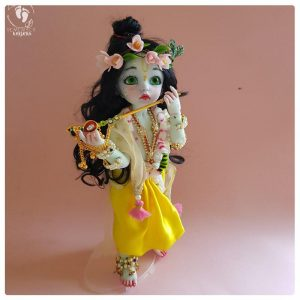 poseable bjd krishna doll holding flute decorated with peacock feathers perfect doll for play