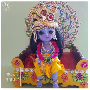 peacock thron with Krsna doll sitting on it, beautiful wooden carved asana for krsna murti